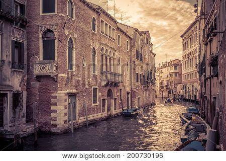 The canal in Venice is a street in the city, Italy. The canal with boats at sunset. Motor boats are the main transport in Venice.