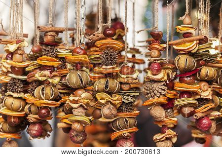 Close-up of dried fruit decoration. Fruits on a string.
