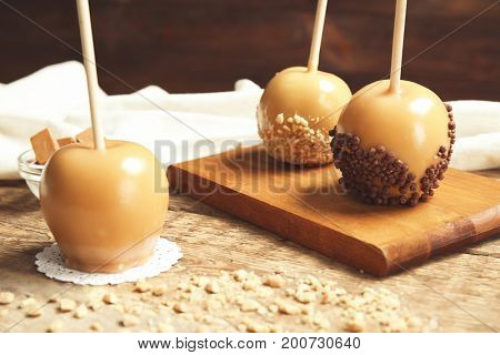 Delicious candy apples on wooden table