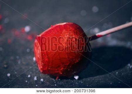 Delicious caramelized apple on table, closeup