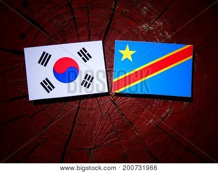 Democratic Republic Of The Congo Flag With South Korean Flag On A Tree Stump Isolated