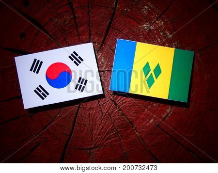 Saint Vincent And The Grenadines Flag With South Korean Flag On A Tree Stump Isolated