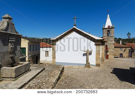 View of the historic village of Castelo Mendo in Portugal with houses and a church; Concept for travel in Portugal