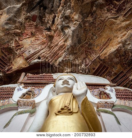 Buddha Statue With Carvings In Kaw Goon Cave In Myanmar.