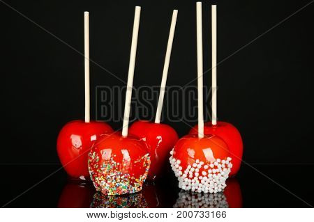 Delicious candy apples on black background