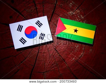 Sao Tome And Principe Flag With South Korean Flag On A Tree Stump Isolated