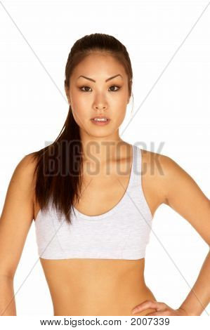 Young Asian In Sports Bra Looking At Camera