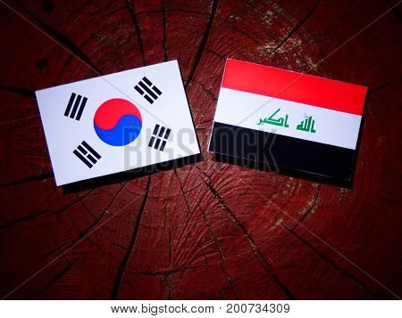 Iraqi Flag With South Korean Flag On A Tree Stump Isolated