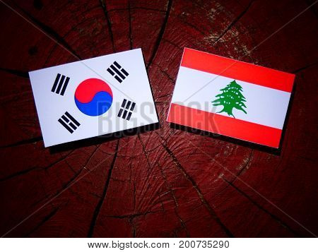 Lebanese Flag With South Korean Flag On A Tree Stump Isolated