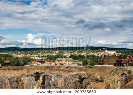 View of the Swedish mining town Falun. Home of the largest copper mine in Sweden with the great shaft in front and the skijumping tower in the back