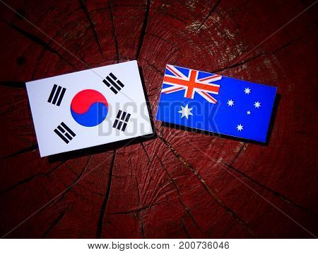 Australian Flag With South Korean Flag On A Tree Stump Isolated