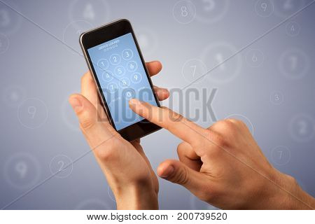 Female fingers touching smartphone with locked device requiring passcode