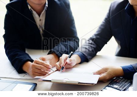 business man talking to consult report paper of financial in office.