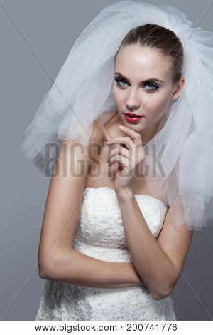 Portrait Of Beautiful Thoughtful Bride