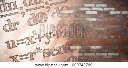 Digital composite image of algebraic formulas against brick wall