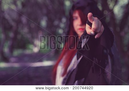 Image of witch pointing finger
