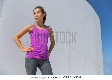 Active healthy Asian sport woman runner portrait confident outdoors. Fitness motivation girl in yoga activewear.