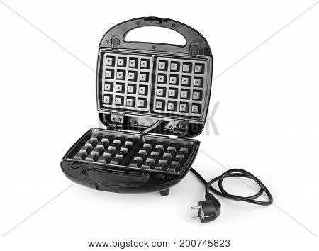 Open waffle iron on a white background with clipping path