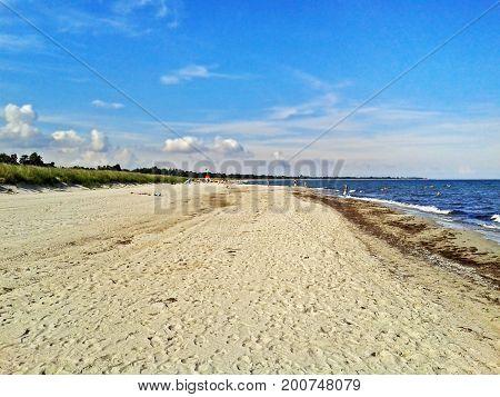 Beach in Marielyst denmark with ocean baltic sea and blue sky