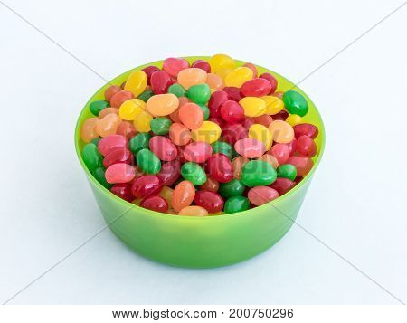 Green Plastic Round Medium Size Bowl For Loose Products Filled With Colored Small-sized Sweets Isola