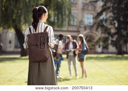 Female Student Looking At Classmates