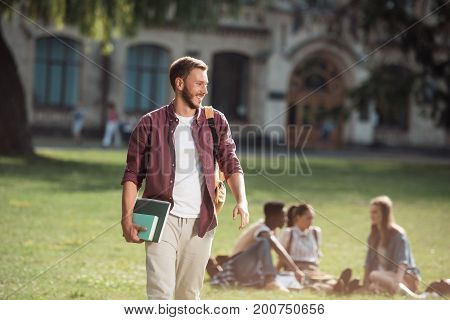 Student With Books Near University