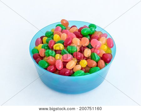 Blue Plastic Round Medium Size Bowl For Loose Products Filled With Colored Small-sized Sweets Isolat