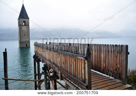 Submerged Tower Of Reschensee Church Deep In Resias Lake Of Bolzano, Italy