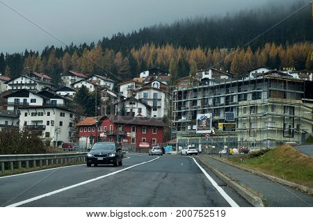 Village In Valley And Traffic Road With Alps Mountain In Bolzano Or Bozen At Italy