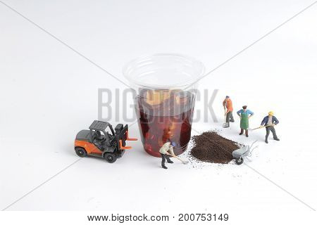 Mini People Workers With Cup Of Drink