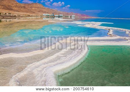 Reduced water in the very salty Dead Sea. Therapeutic Dead Sea, Israel. The concept of medical and ecological tourism poster