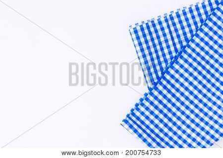 Blue cloth a kitchen towel with a checkered pattern on a white background isolated.