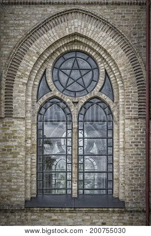One of the ornate arched windows from Haslovs Church in Sweden.