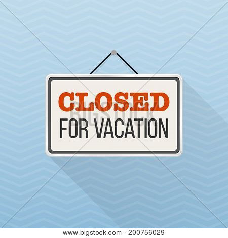 Simple white sign with text 'Closed for vacation' hanging on a blue office wall. Creative business interior template for shop, store, supermarket. Rectangular layout for holiday season