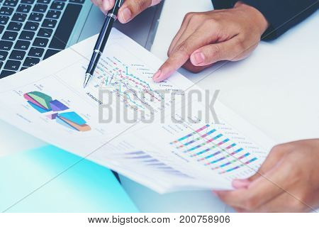 Business concept : Businesswoman pointing figure numbers of total sales comparing between global regions
