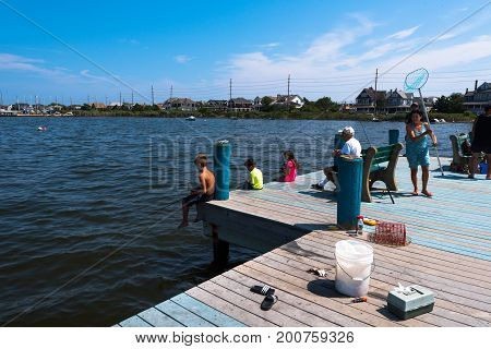 Seaside Heights NJ USA -- August 21, 2017   Youngsters and adults fishing from a pier in Seaside Heights at the Jersey Shore. Editorial Use Only.