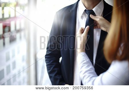 Businessman Prepare To Go To Present The Project And  Adjust Necktie