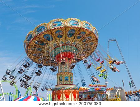 Seaside Heights NJ USA -- August 21 2017 -- People riding the Wave Swinger at the Seaside Heights amusement park. Editorial Use Only.