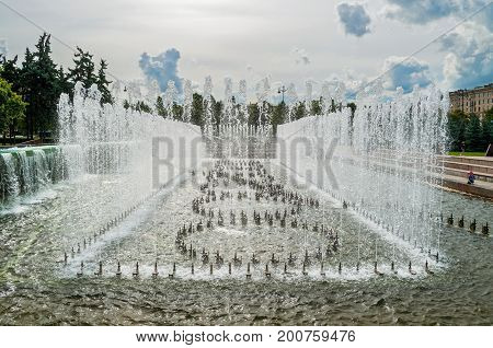 ST PETERSBURG RUSSIA - AUGUST 15 2017. Singing fountains at the Moscow square in St Petersburg Russia in cloudy day. St Petersburg Russia city scene
