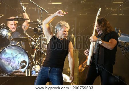 ENDICOTT, NY-Aug 18: (L-R) Tico Torres, Jon Bon Jovi and Phil X perform in concert at En-Joie Golf Course on August 18, 2017 in Endicott, New York.