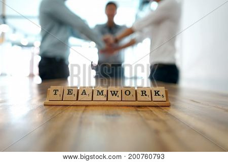 Key Word Teamwork On Wood Table Part Of Business Working.