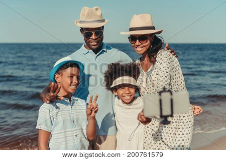 Family Taking Selfie At Seaside