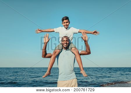 Happy Father Carrying Son On Neck