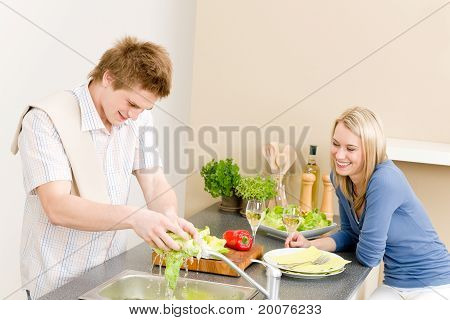 Lunch Happy Couple Cook Salad In Kitchen