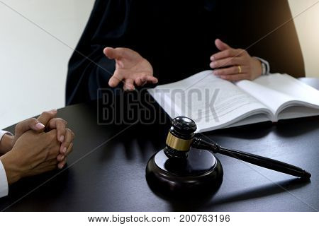 Judge Gavel With Justice Lawyers Plaintiff Or Defendant  Meeting