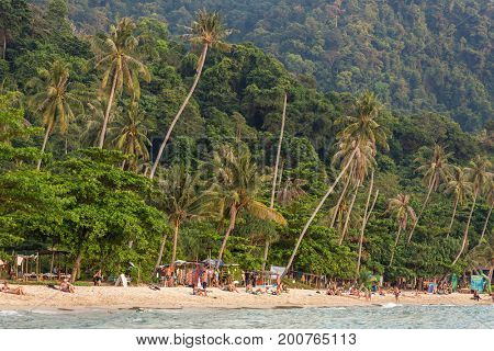 Koh Chang, Thailand - March 19, 2017: Lonely beach on Koh Chang island during sunset in Thailand