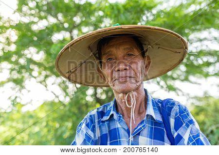 Bagan, Myanmar - Octobert 12, 2016: Portrait of an unidentified burmese farmer in Bagan, Myanmar