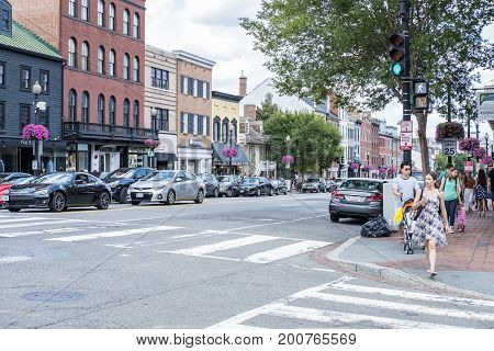 Washington DC, United States of America - August 6, 2017: Busy Street in Georgetown Filled With Shops, Restaurants, Cafes, Shoppers, Cars, etc.
