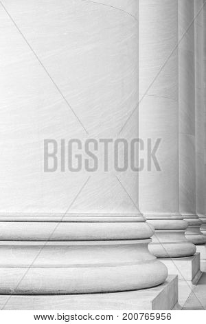 Black and White Photography of a Series of Large Columns of a Building