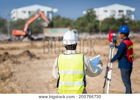 Civil engineer and foreman worker checking construction site for new Infrastructure construction project